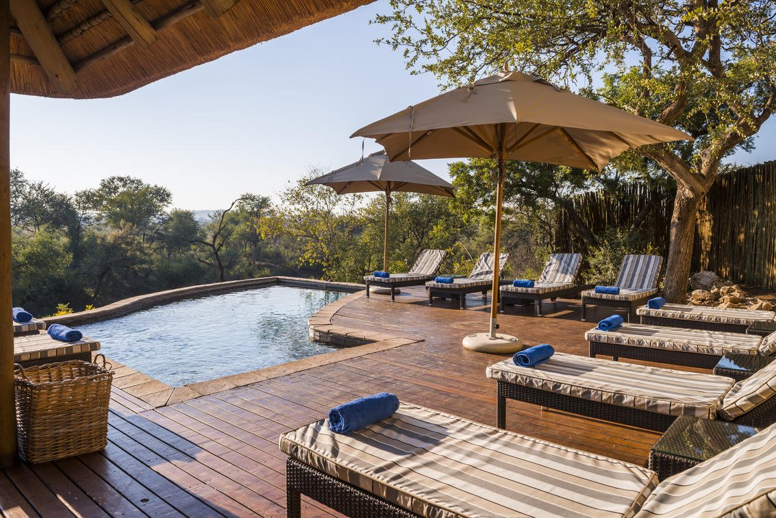 The pool deck at Thakadu River Lodge